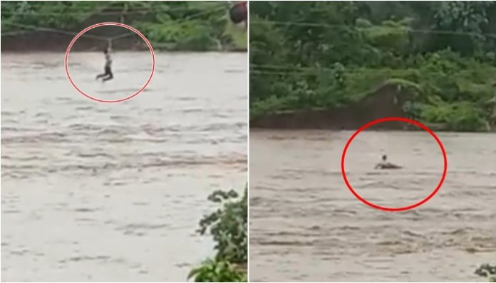 young-man-tried-to-cross-the-river-by-hanging-on-the-hypertension-line-mp
