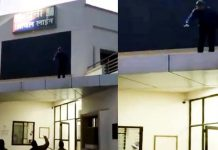 Youth-stand-on-the-building-of-police-station