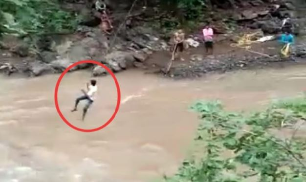 people-from-villages-crossing-the-river-risking-their-lives