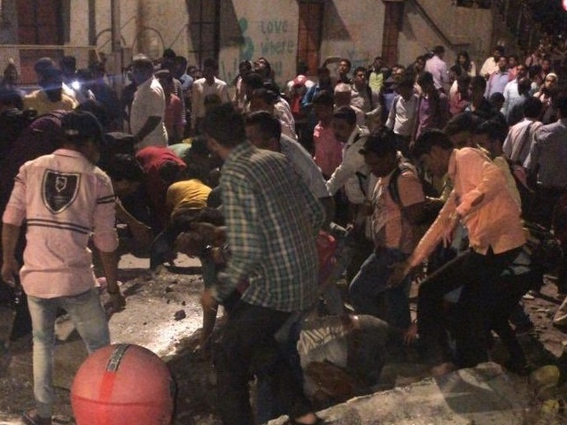In-Mumbai-foot-overbridge-collapses-in-cst-staition-many-people-buried-in-the-rubble