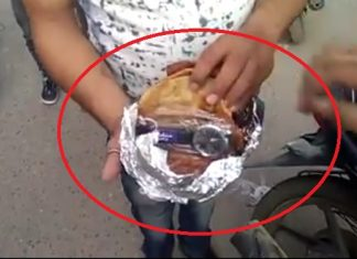 bjp-candidate-distribute-wrist-watches-in-lunch-packet