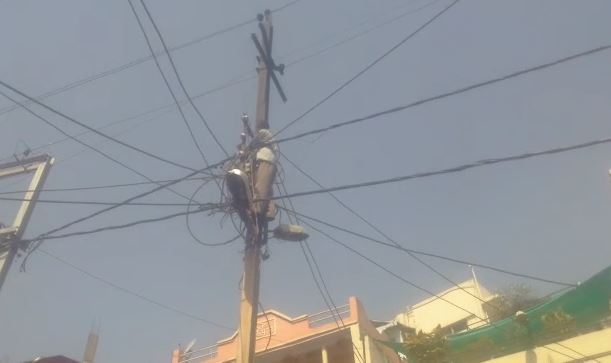-young-man-got-on-the-electricity-pole