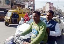 When-the-MP-health-minister-descended-from-the-car-and-sought-the-lift-from-the-bike-rider