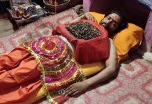 A devotee of Mata doing austerities to end Corona