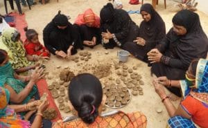 cow dung lamp by Muslim women